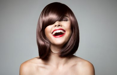 Smiling Beautiful Woman With Brown Short Hair. Haircut. Hairstyl